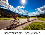 cyclists riding a bicycle on... | Shutterstock . vector #726035425