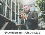 young bearded businessman... | Shutterstock . vector #726044311