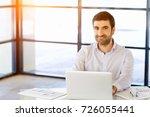 handsome businessman working at ... | Shutterstock . vector #726055441
