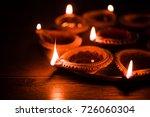 diya in thali   brass plate or... | Shutterstock . vector #726060304