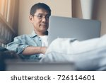 smiling 40s asian man with... | Shutterstock . vector #726114601