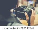 woman holding camera... | Shutterstock . vector #726117247