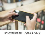 woman touching smartphone... | Shutterstock . vector #726117379