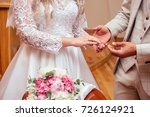 the bridegroom put on a ring on ... | Shutterstock . vector #726124921