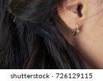 earring on the female ear close ... | Shutterstock . vector #726129115