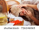 sick young woman on the bed in... | Shutterstock . vector #726146065