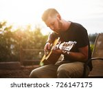 young man playing acoustic... | Shutterstock . vector #726147175