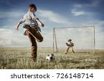 children are playing football | Shutterstock . vector #726148714