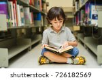 kid sitting reading a book in... | Shutterstock . vector #726182569