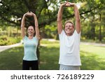 Couple Doing Exercises In The...