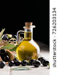 olives and olive oil in a bottle | Shutterstock . vector #726203134