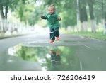 cheerful little girl walks and... | Shutterstock . vector #726206419