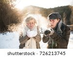 beautiful senior couple blowing ... | Shutterstock . vector #726213745
