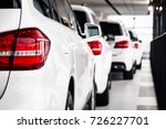 a row of new cars parked at a... | Shutterstock . vector #726227701