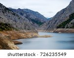 lake in mountains. with white... | Shutterstock . vector #726235549