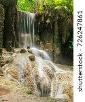 waterfall in the rainforest  | Shutterstock . vector #726247861