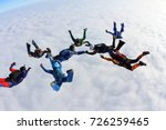the group of skydivers above... | Shutterstock . vector #726259465
