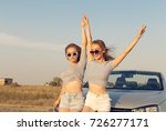 two attractive young women near ... | Shutterstock . vector #726277171