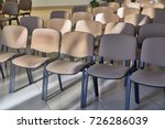 chairs in rows in a room   Shutterstock . vector #726286039