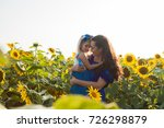 mom and daughter among... | Shutterstock . vector #726298879