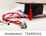 stethoscope and graduate hat. | Shutterstock . vector #726302161