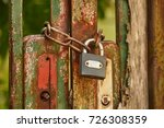 Metal Gate Locked By A Padlock...