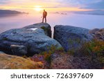 alone tourist with poles in... | Shutterstock . vector #726397609