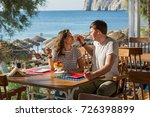 young couple in beach cafe fun... | Shutterstock . vector #726398899