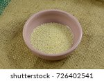 sesame seeds in small pink... | Shutterstock . vector #726402541