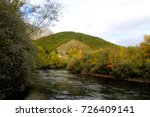 river surrounded by forest with ... | Shutterstock . vector #726409141