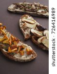 Small photo of porcini mushroom, honey agaric and other in dark bread