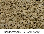 round stones. worn by the sea. | Shutterstock . vector #726417649