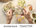 blogger making photo of food... | Shutterstock . vector #726427705