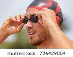 triathlon swimmer athlete going ... | Shutterstock . vector #726429004