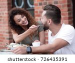 young couple enjoying coffee at ... | Shutterstock . vector #726435391