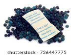 Small photo of Silica gel used as absorbent of moisture over white background