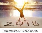 man handstand on the beach... | Shutterstock . vector #726452095