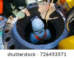 confined space entry by a... | Shutterstock . vector #726453571