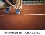 runner man tying shoelaces... | Shutterstock . vector #726462787