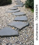 Path Of Plated Stones On Grave...