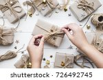 female decorating christmas... | Shutterstock . vector #726492745