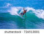 riding the waves. costa rica ... | Shutterstock . vector #726513001