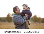 father and son having fun... | Shutterstock . vector #726529519