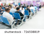 Small photo of blurry background of people sit on the waiting area wait for contact a government transaction affair service.