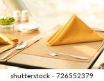folded napkin on the set up... | Shutterstock . vector #726552379