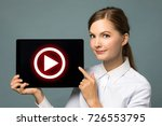 young woman showing movie play... | Shutterstock . vector #726553795