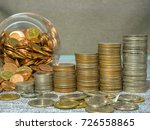 Small photo of Idea of money saving that like coin accumulation in column.