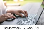 human hands typing on laptop... | Shutterstock . vector #726562171