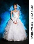 beautiful girl  in wedding dress in smoke - stock photo