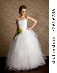 beautiful girl  in wedding dress with tulips - stock photo